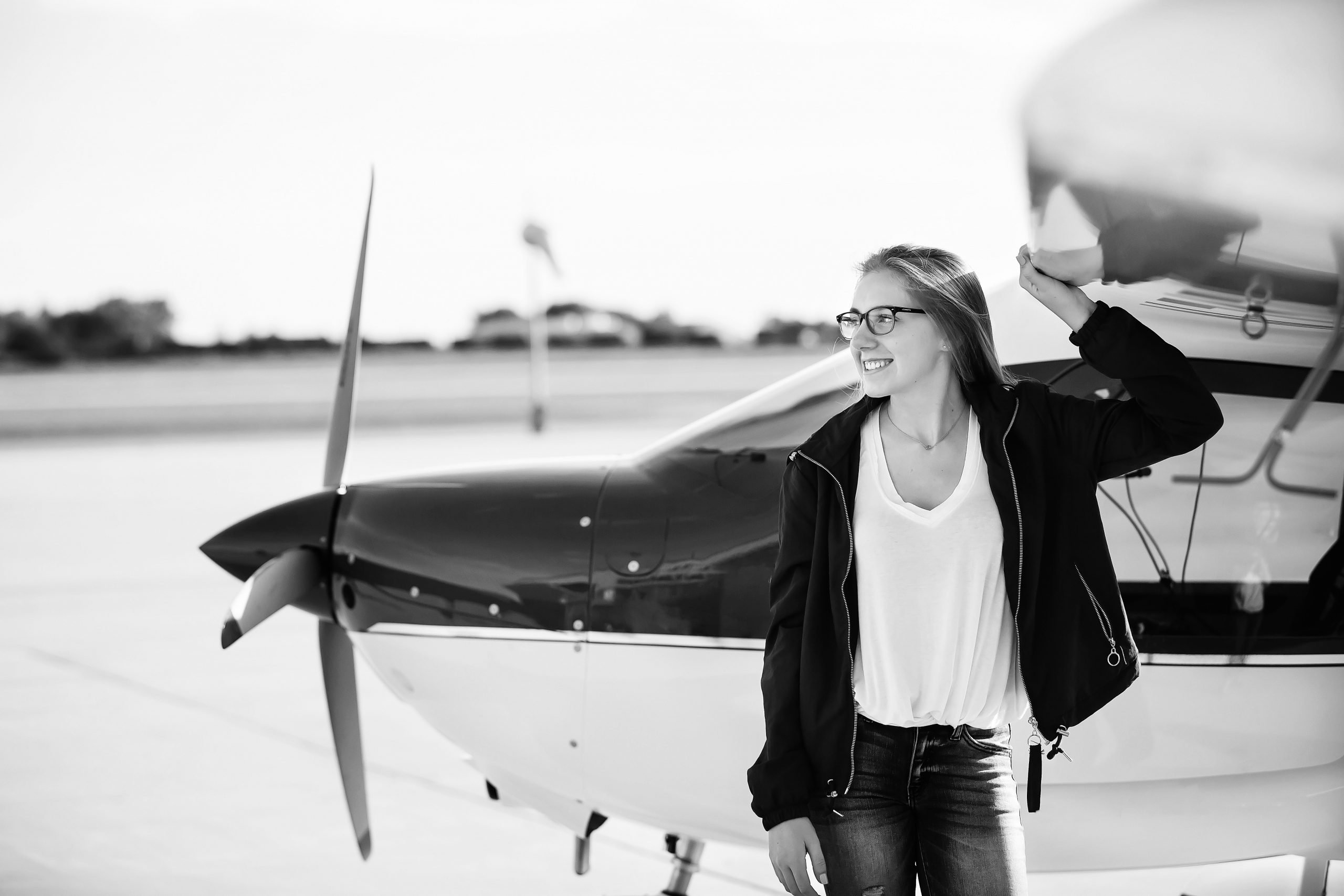 senior portraits; high school senior girl standing next to an airplane