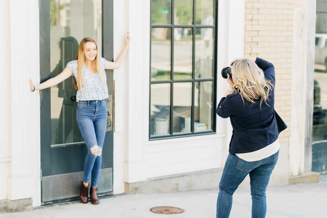 professional senior portrait photographer take photo of a senior girl